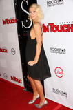 Paris Hilton in black low-cut dress at In Touch Weekly's Summer Stars Party in Los Angeles