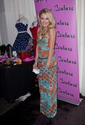 http://img109.imagevenue.com/loc151/th_513211174_Emily_Osment_at_GBK_Gift_Lounge4_122_151lo.jpg
